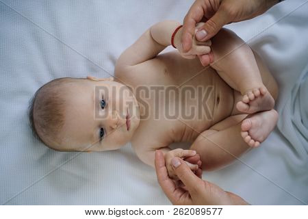 poster of Happy Little Baby Enjoy Doing Gymnastics. Little Baby Enjoy Motor Activity. Happy Newborn At Home. D