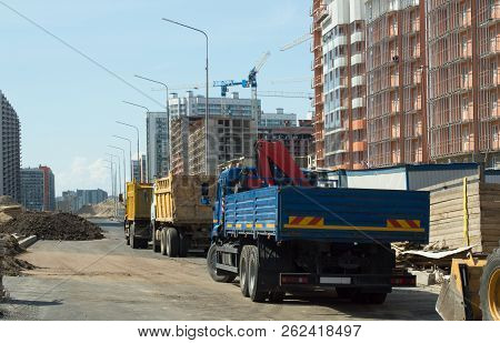 Trucks Construction Machinery And Highrise