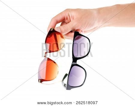 poster of Hand Holding Two Sunglasses. Men's And Women's Sunglasses. Close Up. Isolated On White Background