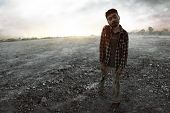 Scary Zombie Man Walking Outdoor At Sunset poster
