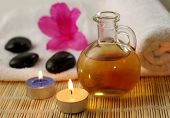 stock photo of massage oil  - Warm massage oil and accessories - JPG
