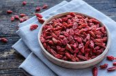 Superfood Goji Berries In Ceramic Bowl On Wooden Background. Wolfberry For Healthy Clean Eating. Hea poster