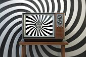 Propaganda and brainwashing of the influential mass media concept. Vintage TV set with hypnotic spir poster