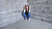 Desperate Unhappy Woman By The Wall. The Concept Of Stress And Hopeless poster