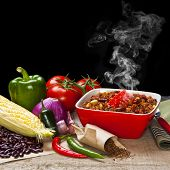 Chilli And Ingredients With Steam Rising - A Bowl Of Chilli With Its Ingredients, And Visible Steam  poster