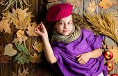 Fashion Trend Fall Season. Child Lay Wooden Background Fallen Leaves Top View. Knitted Accessory Fas poster