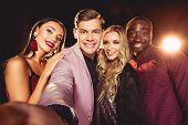 Smiling Glamorous Young Multiethnic Friends Taking Selfie poster