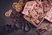 Decorating gingerbreads. Handmade cookies, confection lying on a grey background. Christmas and New  poster