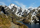 A Hiker And Lake Harris On The Routeburn Track.  Aspiring National Park, Southern Alps, New Zealand poster