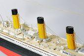 Handmade Model Of Titanic. Beautiful Handmade Model Of Titanic Isolated On White Background. poster