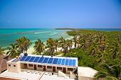 birdeye view on the beach with a building with a solar panel on the Isla Contoy, Mexico poster