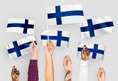 Hands waving flags of Finland poster