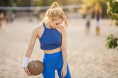 Young Beautiful Sporty Girl Outdoor In Volleyball Game. Attractive Slim Sexy Woman Standing With Bal poster