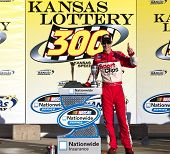 KANSAS CITY, KS - OCT 02:  Joey Logano holds off a hard charging field to win the Kansas Lottery 300