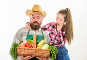 Family Farm Organic Vegetables. Father Farmer Or Gardener With Daughter Hold Basket Harvest Vegetabl poster