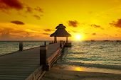 pic of dhoni  - Awesome vivid sunset over the jetty in the Indian ocean - JPG