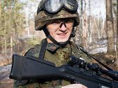 image of hider  - The portrait of the soldier with rifle - JPG