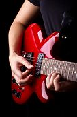 stock photo of potentiometer  - Closeup view of playing electric red guitar - JPG