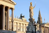 picture of fountains  - The Austrian Parliament Rathaus and Athena Fountain in Vienna Austria - JPG
