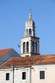 stock photo of luka  - House and top of bell tower in Vala Luka Croatia - JPG
