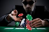 stock photo of spade  - Portrait of a professional poker player - JPG