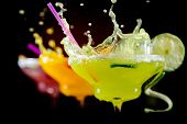 stock photo of vodka  - Fruit cocktails on black background - JPG