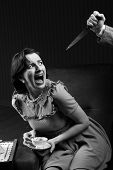 stock photo of terrifying  - Terrified woman by a man murderess with a knife - JPG