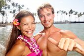 stock photo of hula dancer  - Hawaii couple happy on Hawaiian beach - JPG