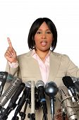 stock photo of public speaking  - Woman giving speech behind microphones during press conference - JPG