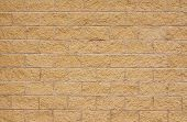 stock photo of grout  - beige sandstone wall with lighter concrete grouting a good background with room for overlaid text type sign or poster - JPG