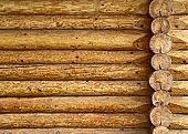 image of log fence  - background or texture of a wooden log cabin wall - JPG