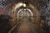 stock photo of underworld  - Dirty pedestrian tunnel at night - JPG