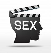 stock photo of porno  - Sex movies and erotic film concept with a movie equipment clapboard shaped as a human head representing the sexual entertaimment film industry - JPG