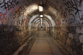 foto of underworld  - Dirty pedestrian tunnel at night - JPG