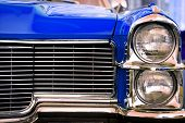 foto of muscle-car  - Color detail on the headlight of a vintage car - JPG