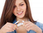 stock photo of scandinavian descent  - Attractive teenage girl cracking cigarettes - JPG
