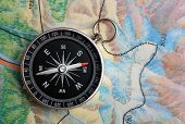 picture of orientation  - compass on geography map  - JPG