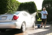 picture of car wash  - Senior man washing the car at home - JPG