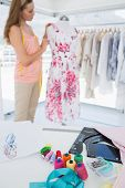 picture of dress-making  - Side view of a beautiful female fashion designer working on floral dress at the studio - JPG