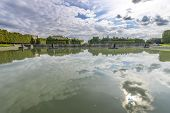foto of versaille  - View of Versailles Chateau gardens famous fountains near Paris France - JPG