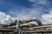 foto of gases  - cooling pipe from industrial air system with blue sky - JPG