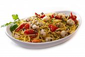 stock photo of cuttlefish  - dish with spaghetti with cuttlefish and tomatoes - JPG