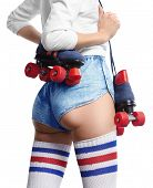 stock photo of roller-skating  - girl with a roller skate stands back showing ideal buttocks separate on white background - JPG