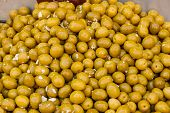 foto of deli  - Heap of green olives with chopped garlic at a deli stall in Machane Yehuda Market Israel - JPG