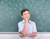 stock photo of pre-adolescent child  - Portrait of child school education against the background of blackboard - JPG