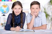 foto of pre-adolescent child  - Portrait of a school child making learning during lesson at school - JPG