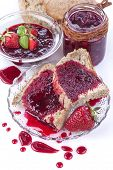 stock photo of home-made bread  - Homemade organic strawberry jam on wholemeal bread - JPG
