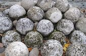 stock photo of cannonball  - Stone cannonballs in Kremlin of ancient russian city Veliky Novgorod - JPG