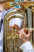 foto of orchestra  - Close up view of musician playing tuba in street orchestra - JPG