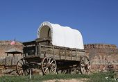 stock photo of wagon  - Western wagon on display in Arizona desert - JPG